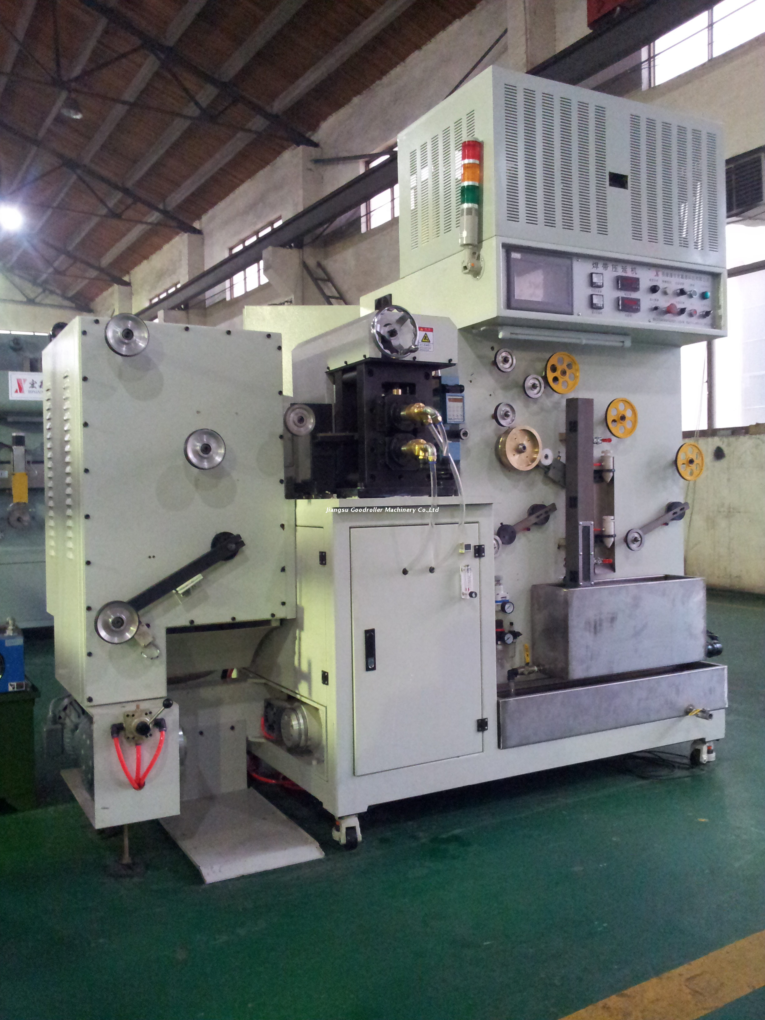 Rolling and drawing machine for enameled ribbon